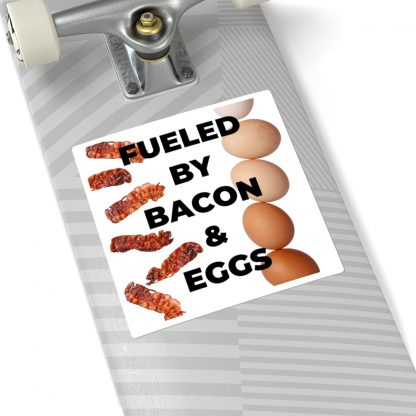 Fueled By Bacon & Eggs Sticker On Skateboard